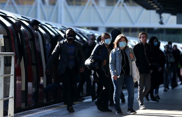 People wearing face masks on commute